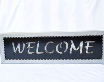 Welcome sign - back lit with mosaic tile