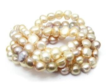 Naturally coloured all nacre super shiny potato pearl strands