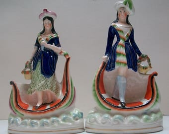 Victorian Staffordshire pair Figures standing in boats