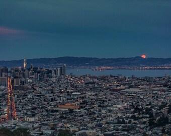 Full moon rises over San Francisco