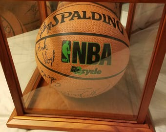 Autographed Indiana Pacers Basketball with case.