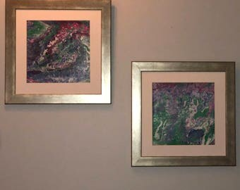 """2 coordinating Paint pours in white, pink, green, purple, blue in metallic silver frame 19""""x19"""" (sold as set)"""