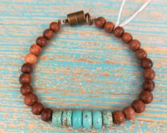Turquoise and wood beaded bracelet.