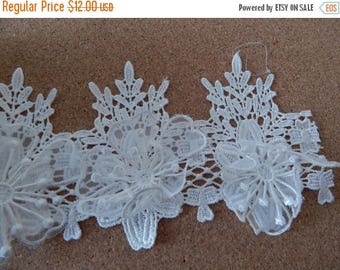 CLEARANCE - White lace trim with raised floral detail, 3 x 48 inches