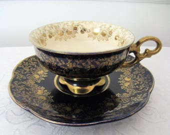 Dark Blue And Gold Vintage Footed Teacup And Matching Saucer