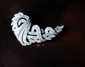 Art deco style vintage 80s, clear rhinestones, diamonds set brooch.Made by Polcini.