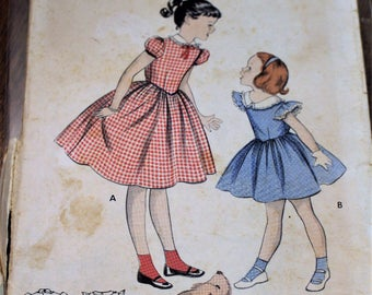 Vintage Butterick sewing pattern #7193; ©1955; Girls' Size 8; Full-skirted dress with elastic waist; Sleeve & Neckline variations; COMPLETE