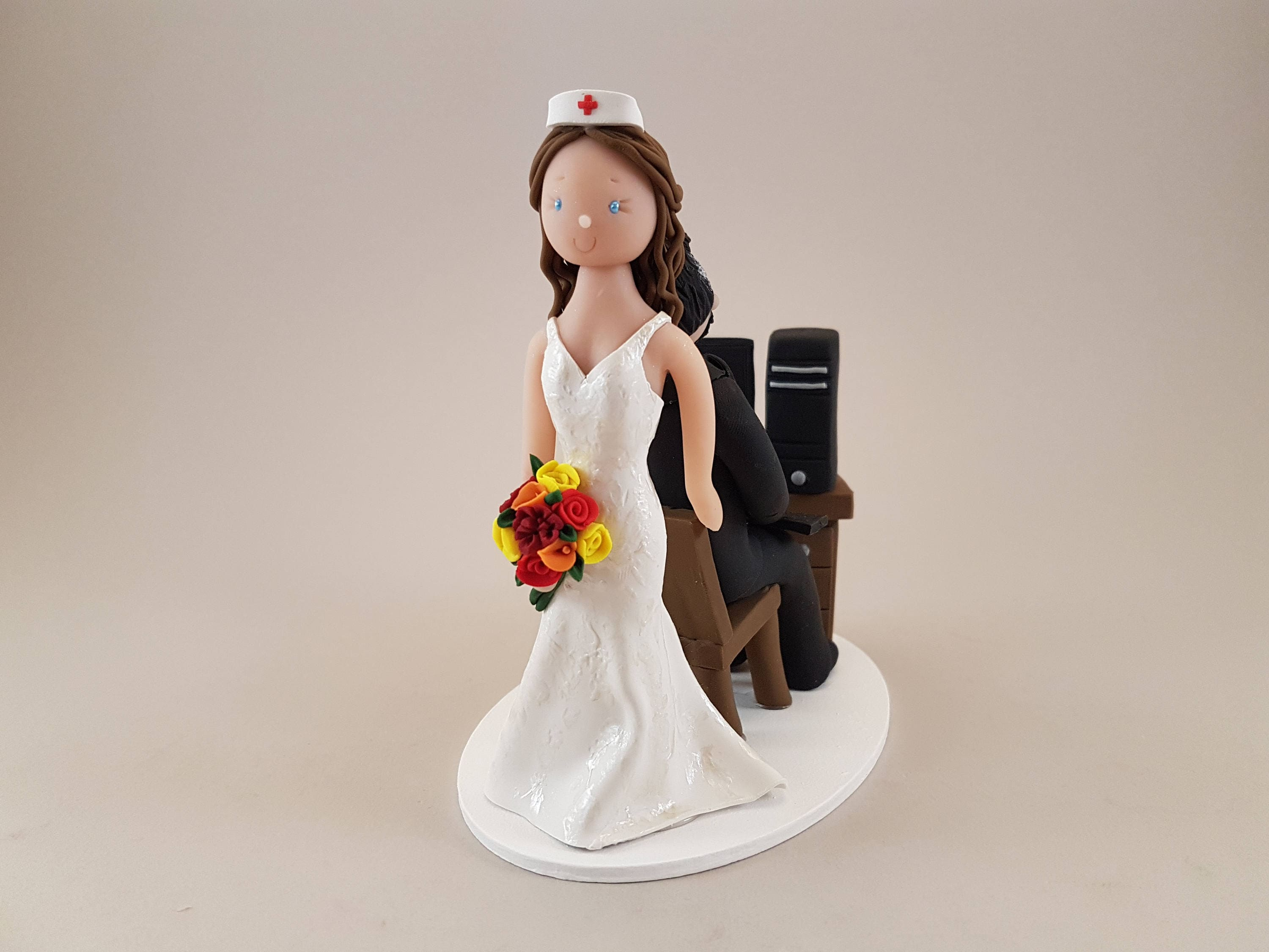 Nurse Dragging Computer Geek Customized Wedding Cake Topper