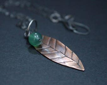 Antiqued Silver Necklace with Copper Stamped Leaf and Green Glass Bead Charm