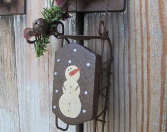 Primitive Hand Painted Snowman on Sled Ornament GCC5539