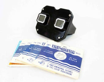 Vintage View-master in Black with 11 Reels. Circa 1950's.