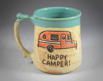 Wheel Thrown Hand Carved Orange Happy Camper Mug in Light Shino and Antique Jade Glazes