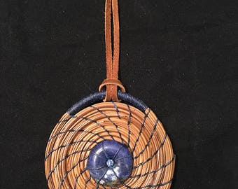"3"" Coiled Pine Needle Ornament with Blue Stone Center"