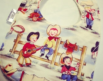 On Sale Cowpokes - Infant or Toddler Bib - Terry Cloth Backing - Reversible with ADJUSTABLE Snaps