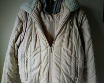1980s women's hooded ski jacket with removeable sleeves size medium