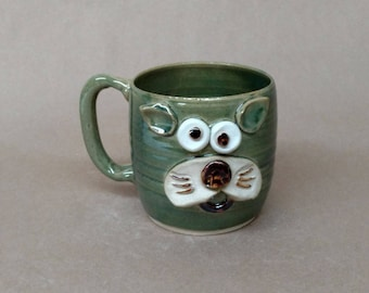 Meow Face Cat Hot Coffee Mug. Rustic Speckled Green Stoneware Pottery. Microwave and Dishwasher Safe Nelson Ug-Chug Mug. Handcrafted in USA