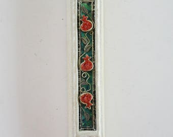 A vintage cast stone mezuzah made in Israel .