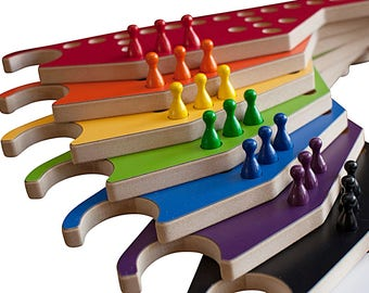 New PEGS and Jokers 8-pc Game with Interlocking paddles.
