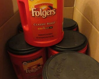 Empty Folgers coffee cans, containers for storage and organization from cookies to garage items.