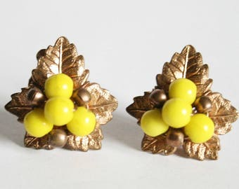 Vintage leaf earrings.  Yellow bead earrings.  Clip on earrings