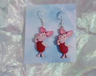 Earrings made with piglet figures pooh bear figures brockus creations earrings