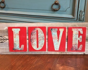 LOVE and arrow rustic wooden sign