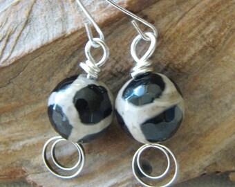 Black, white, and silver dangle earrings