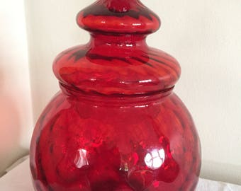 A stunning vintage Empoli lidded, textured glass jar in ruby red