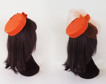Jackie O hat in orange silk with optional but included birdcage veil on comb