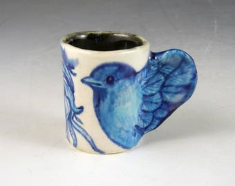 "Miniature bird cup porcelain in blues with wing handle and lady 1.75"" tall"