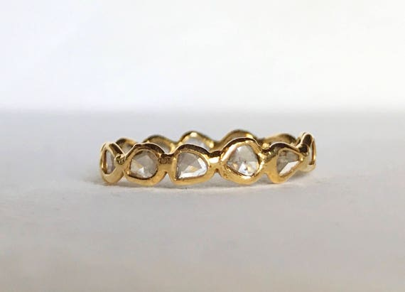 Diamond slice eternity band in 18k gold