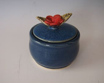 Small, ceramic, wheel thrown lidded jar- dark blue with red flower