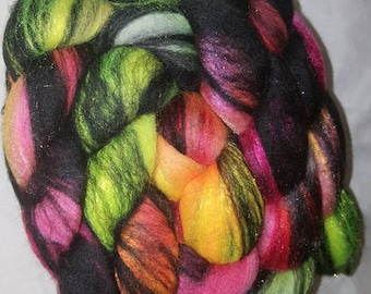 Stained Glass Merino Firestar combed top. Neon yellow orange and pink