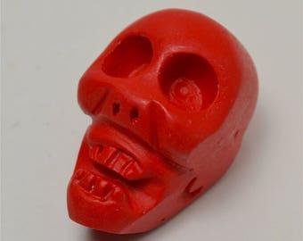 Carved cinnabar skull pendant bead  CB107