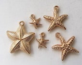 salvaged hollow lightweight champagne gold metal starfish pendants and charms--mixed lot of 5