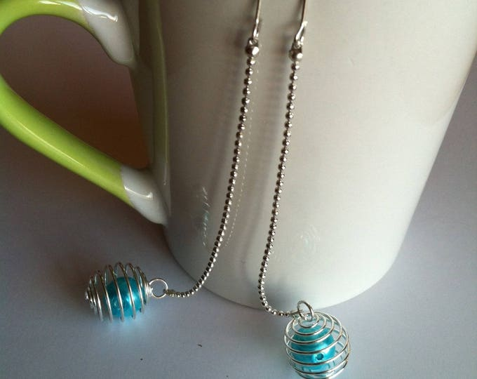 Spiral turquoise long earrings