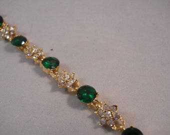 Gold Link Bracelet with Clear Rhinestones and a Green Crystal Center Bead