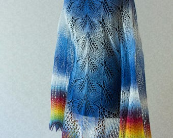 Hand Knit wool shawl in blue and white and rainbow on the ends.