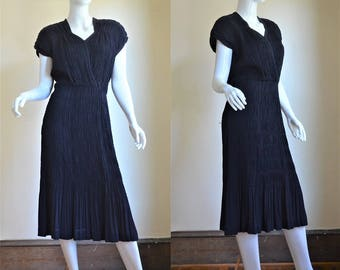 1940s Gothe' Navy Blue Silk Crepe Heavily Shirred Dress with Dramatic Shoulder Pads