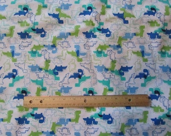 White with Blue/Green/and White Dinosaurs Flannel Fabric by the Yard