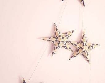 "The ""6 magic stars"" paper Garland and small blue flowers"