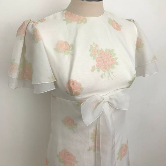 Vintage maxi dress pastel flowery babydoll flower power 60s bridesmaid white peach blooms chiffon butterfly sleeves UK 8 bow 1970s