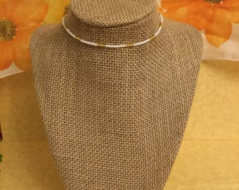 Delicate white and gold choker