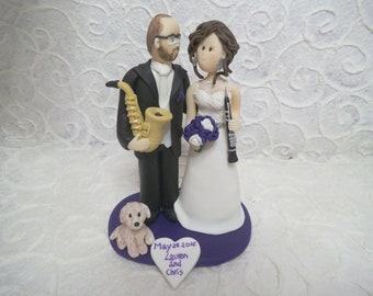 custom bride playing clarinet and  groom playing saxophone wedding cake topper