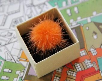 Funny ring orange pompon made of mink fur