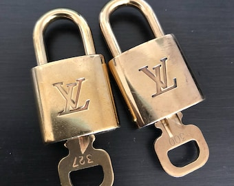 Set of 2 Louis Vuitton padlock and one key #300 and #327 bag charm lock item#7047