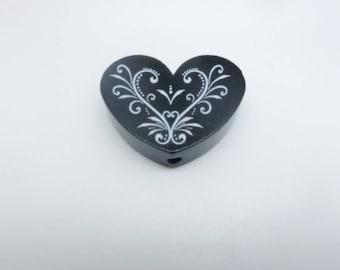 A wooden heart shaped bead