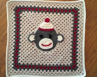 Adorable Crochet Granny Square Blanket for Sock Monkey Fans - Monkey in the Middle