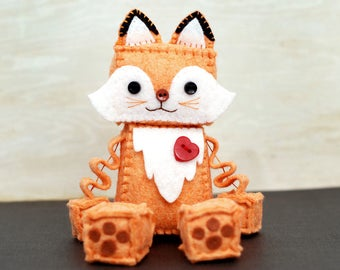 Fox Plush Robot with Paws and a Red Heart