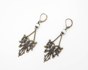 Earrings with charms and pearls